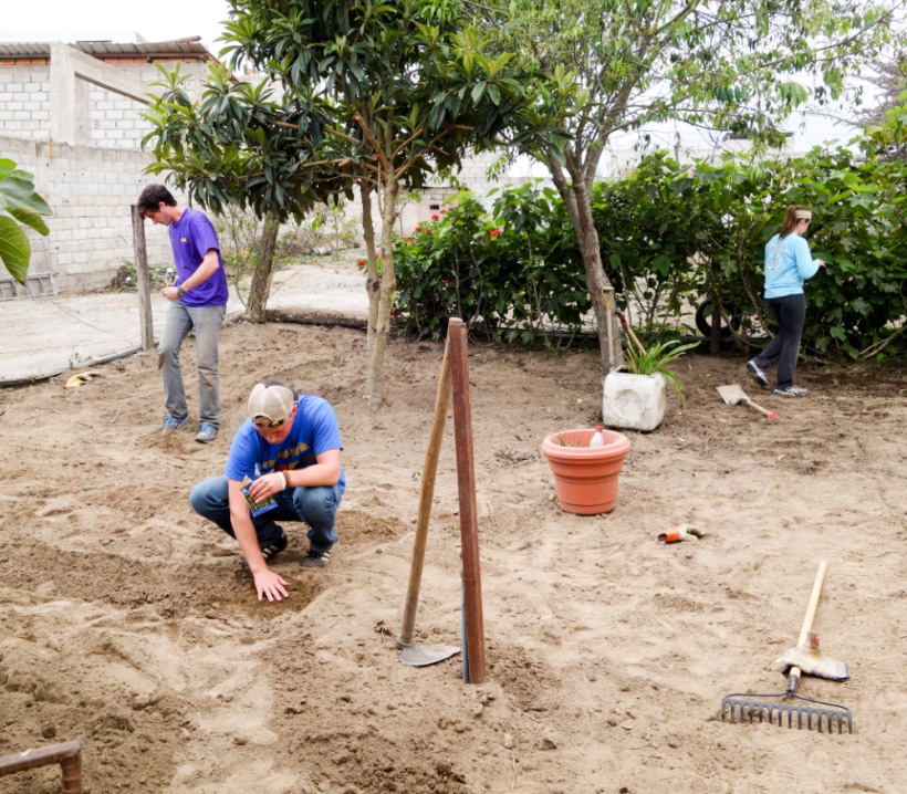 Louisiana State volunteers plant a garden at a daycare in Ecuador