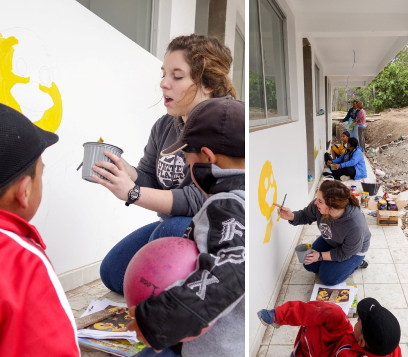 Louisiana State volunteers painting a mural at a daycare in Ecuador