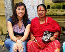 A younger woman sits next to an older woman in Nepal.