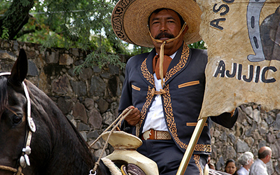 Older Mexican man on horse celebrates Happy Independence Day