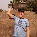 United Planet volunteer balances bowl on head