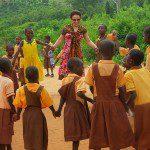 Volunteer dancing with children in Ghana
