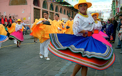 Dancing in traditional costumes in Ecuador
