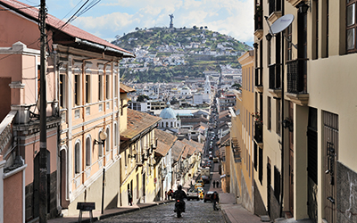 The El Panecillo hill seen from Quito's historic centre along the García Moreno street