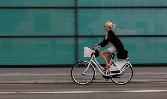 Blonde woman rides her bike in Denmark