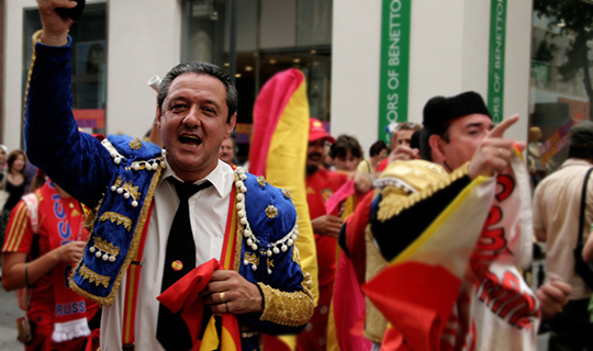 Male spanish football supporter celebrates in street
