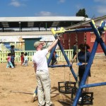 Volunteers painting a swing set in Chile