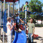 Volunteers on playground with children