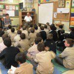 Children in classroom with teaching volunteer