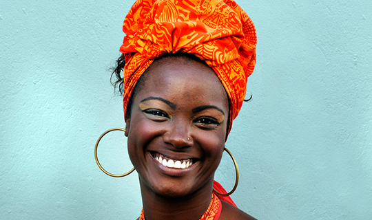 Brasilian woman smiles at the camera