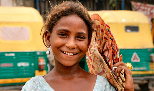 Child smiles into the camera in India