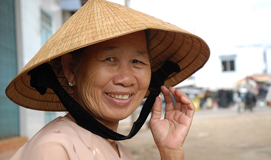 Vietnamese woman smiles at the camera