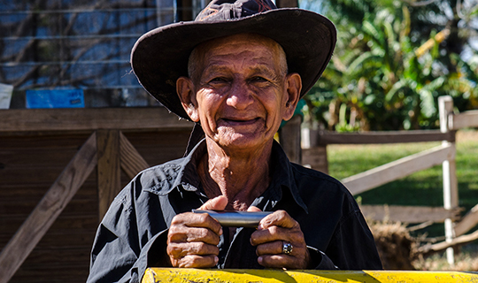 Male Costa Rican farmer smiles at the camera