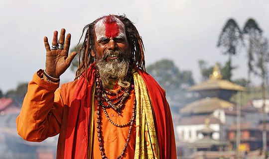 Pashupatinath Holy Man waves at camera in Nepal