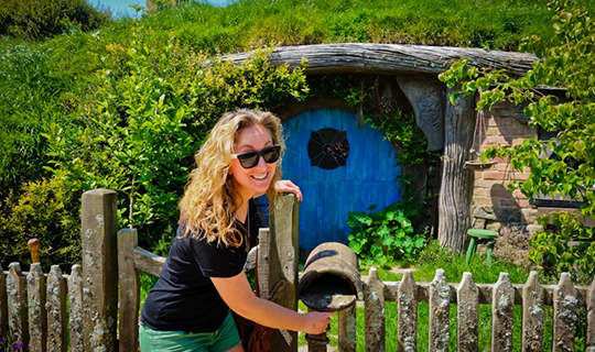 United Planet volunteer poses in front of Lord of the Rings film set in New Zealand