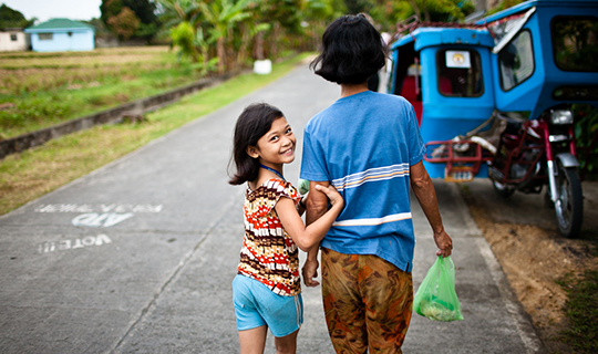 Young girl looks back at camera in Donsol, Philippines