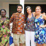 Volunteers with community members in Ghana