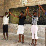 Community members dancing in a classroom in Ghana