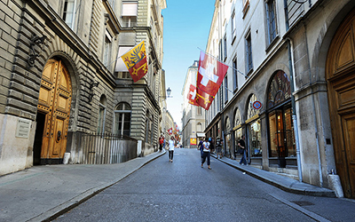 Shopping street in Geneva with flags hanging on either side