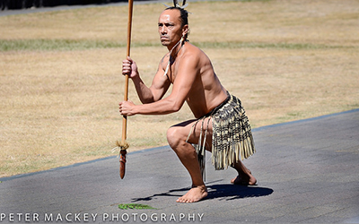 Maui man poses on road in traditional clothing