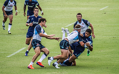 Man tackles another man in a game of rugby