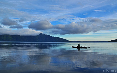 Photo of Fisherman at Ranau Lake, Bali, Indonesia