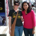 Two female volunteers pose on street in Nepal