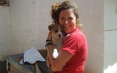 Volunteer holding puppy in Peru