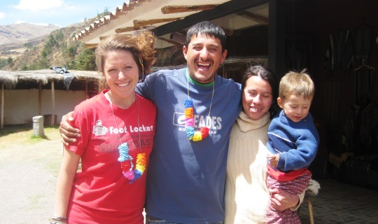 Volunteer and host family in Peru