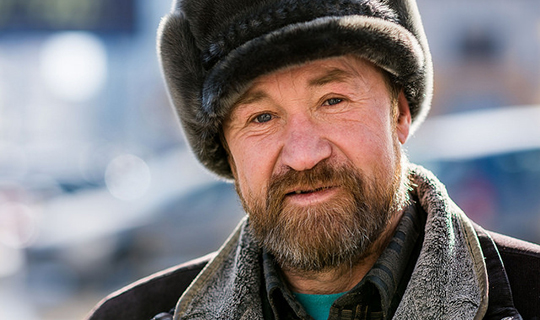 Russian Man looks into the Camera in Siberia