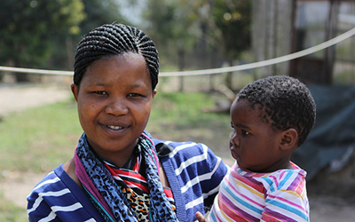 A sangoma in training and her little one