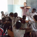 Volunteer leading a class of young students in Tanzania