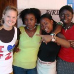 Volunteer with community members in Tanzania