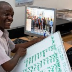 Tanzania Country Director with whiteboard