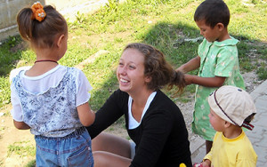 Volunteer working with children at women's shelter in Chile