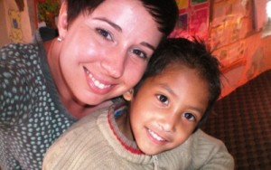 Volunteer with a child at the counseling center in Nepal