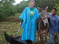 volunteer poses with donkey in costa rica