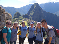 Volunteers pose on Machu Picchu