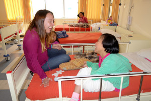Volunteer in hospital with young girl